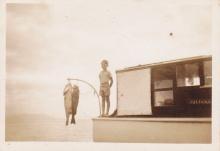 KEN & 70 LB HAPUKA AT KAWAU ON JULIANA CIRCA 1947