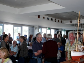 The crowd. Model of Paul Markson on the bar and Rod Jenden.