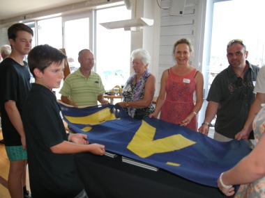 The Vos and Ostick clan launching the book in true Percy Vos style. This flag has launched may boats from the P. Voss yard