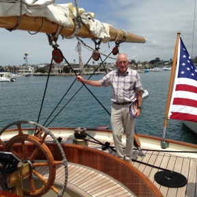Barry Dreyer posing on the aft deck of the Schooner America Replica.