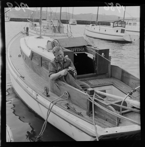 Mr W MacQueen on his yacht Christina 1956